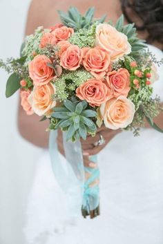 bridal bouquet with peach roses and succulents wrapped with mint ribbon @myweddingdotcom