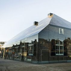 MVRDV disguised a glass building as a brick farmhouse (above) and a team of Danish architects disguised a housing complex as a group of icebergs (below). Our track of the week from Dezeen Music Project is also below, plus a roundup of our top stories from this week.