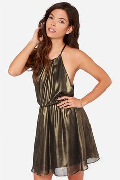 """You've followed your map to this exact spot, now it's time to claim your prize: the Treasure Huntress Bronze Dress! Lightweight chiffon has a dazzling metallic bronze finish falling from a high-rounded halter neck, into a sleeveless bodice with low-cut, overlapping arm openings. A gold button closure joins a sexy keyhole cutout at back, while the gathered elasticized waist tops the full circle skirt below. Fully lined in black stretch knit. Model is 5'7"""" and is wearing a size small. 100%…"""