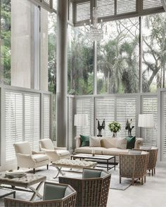Chanintr Living - Portfolio. Love these high ceilings dressed with shutters. Clean, sleek living room.
