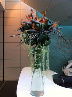 Strelitzia'a and Aspidistra leaves make a contemporary arrangement