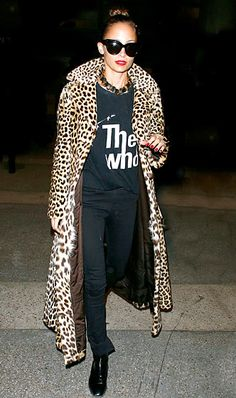 Nicole Richie wearing a leopard print coat and vintage t-shirt.