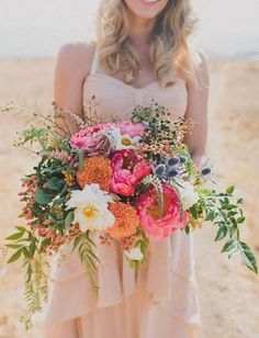 Peonies, dahlias, seaholly, pepperberry and other textured elements really make this bouquet a standout.