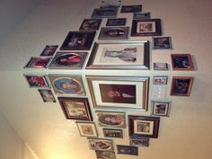 Photos arranged on the corner of a wall. Could do the same arrangement on the inside of a corner too!