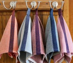 Overview: A fun and practical handwoven hand towel for kitchen, bathroom, mudroom, or even boat, with an integrated hanging tab that is woven right in. Get a different color for each member of the family or guest (see photo 5)!  Size: 17.5 inches by 17 inches, perfect for a hand or guest towel.  Style: Woven, by hand, in a twill variation. The dark stripe down the middle extends to form a hang tab--so handy! Designed to hang, in a jaunty manner, from a decorative hook or knob.  Content…