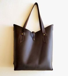 Vera Leather Tote Bag | The belted chevron opening on this sleek leather tote is desig... | Handbags