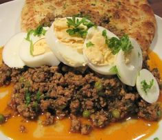 Spicy Indian Keema with Beef & Pork Mince, spices, spinach & peas. Serve with hard boiled eggs and Naan Bread or Chapati.