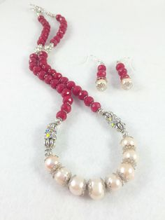A personal favorite from my Etsy shop https://www.etsy.com/listing/268013277/brazilian-red-ruby-freshwater-pearl-and