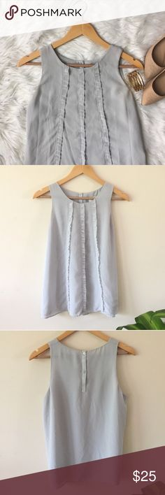 "{LOFT} Grey Ruffle Blouse This blouse is a beautiful pearly grey. Double lined an excellent condition! Buttons in the back.  Length: 25"" \ Bust: 19"" flat LOFT Tops Blouses"
