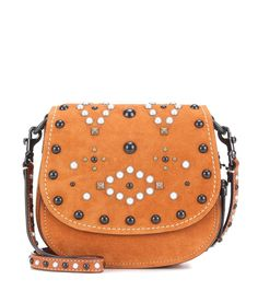 Coach - Saddle Small embellished suede crossbody bag - In the label's signature Western-inspired style, Coach presents the Saddle Small crossbody bag. The amber-tan suede is decorated with a variety of studs for a girly take on the rustic look. The compact shape is perfect for carrying your daytime essentials. Carry yours effortlessly cross-body for a hands-free option. seen @ www.mytheresa.com