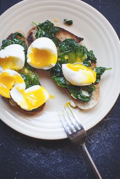 Breakfast recipe: Soft-boiled eggs atop sauteed spinach  rosemary-salt bread