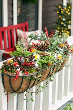 Add seasonal greenery to your outdoor planters for a festive and bright entrance. Here, we used a mix of berries, evergreen sprigs, and pinecones in various sizes to create this easy front porch decoration. Best Outdoor Christmas Decorations, Christmas Greenery, Christmas Porch, Christmas Tree Ornaments, Christmas Lights, Christmas Ideas, Outdoor Decorations, Christmas Design, Xmas Decorations