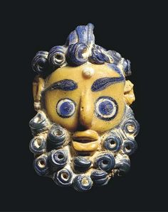 A Phoenician or Carthaginian Glass Pendant in the Form of a Bearded Male Head 4TH-3RD CENTURY B.C.