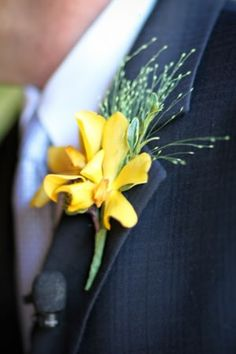 A yellow orchid boutonniere by Pat Gibbons Floral Designs.