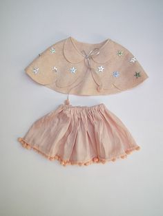 the amazingly talented jenni harley - cape + skirt doll clothes - would be lovely for children too~