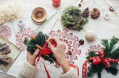 Stock photo of Christmas Season - Overhead Shot of Woman Tying Cinnamon Sticks and Fir Twigs to Big Red Candle by visualspectrum Christmas Drinks, Christmas Gift Tags, Christmas Decorations, Xmas, Table Decorations, Red Candles, Woman Drawing, Cinnamon Sticks, Design Elements