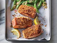 Make Panko Salmon With Snap Peas In 20 Minutes | Fresh tarragon kicks this simple, classy main up a notch. It has a sweet, anise-y flavor that pairs beautifully with pungent Dijon mustard (try the two together in a vinaigrette or meat marinade). Make sure to sear the salmon fillets with the crusted side down first; it will be easier to flip once crisp and golden. We love the sweetness of crisp-tender snap peas. You could also use haricots verts (French green beans) or broccoli florets.