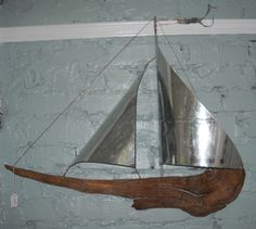 Driftwood and vintage metal hanging sailboat. www.rlbrethauer.com.
