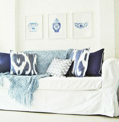 some blue pillows and art to bring out blue in ocean. White and blue look so fresh together.