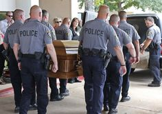 The casket of Oklahoma City canine officer K-9 Kye, is carried into a waiting hearse following funeral services for the dog in Oklahoma City...