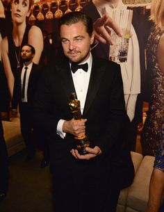 Leonardo DiCaprio in Armani seen the 2016 Vanity Fair Oscar Party, (holding his Oscar. Friend Toby Maguire's in the backgound). Oscars, Brian Grazer, Cinema, Movie Party, Oscar Winners, Vanity Fair Oscar Party, Poses For Photos, John Legend, Vogue
