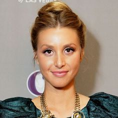 #WhitneyPort kept her hair in a loose center-part before twisting it up into a high #TopKnot, giving her simple style a touch of polish and bit of shape. http://news.instyle.com/photo-gallery/?postgallery=129935#