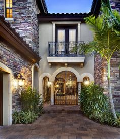 """Courtyard Entry of Sater Design's """"Casoria"""" home plan from our European Home Plan collection. #luxuryhomeplans #luxuryhouseplans www.saterdesign.com"""
