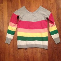 Striped sweater Very cute colorful striped sweater. 2 decorative buttons on top of back. 3/4 sleeve length. Tags were removed but size small. In like new condition. I have only worn it once or twice as it is a bit too small & short on me. Sweaters