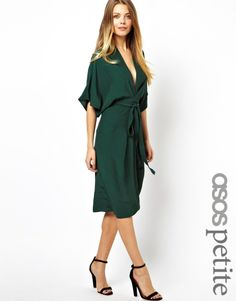 Dress by ASOS PETITE    Made from a soft touch woven fabricPlunging necklineWrap frontSelf tie waistWide-cut sleevesKick split to reverseRegular fitABOUT ASOS PETITEASOS PETITE brings forth a trend-led collection specifically designed to fit women of 5'3/1.60m and under.  Adapting directional designs, key pieces and best-sellers from our mainline range, the collection also features an exclusive range of styles especially created for our petite customers with carefully considered ...
