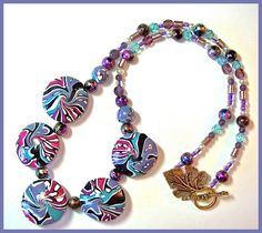 https://www.etsy.com/listing/249417012/swirl-necklace-19-in-purple-magenta?ref=shop_home_active_5