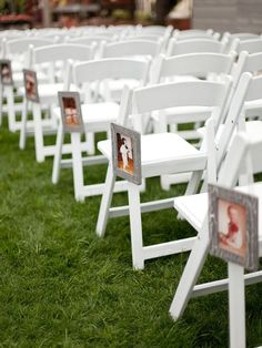 wedding aisle chairs hanging pictures of the bride and groom at various ages .
