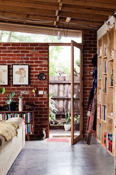 brick wall, library, dark floor