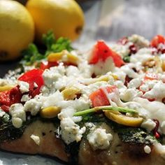 A quick, easy, and flavorful Mediterranean-style pizza, made with pita bread and topped with a lemon dressing.  Allrecipes.com