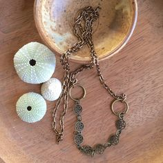 A personal favorite from my Etsy shop https://www.etsy.com/listing/262743918/long-chain-burnished-metals-necklace