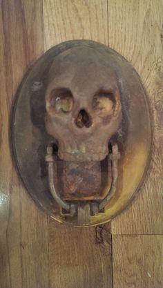 Weathered Rusty Skull Door Knocker Sculpture