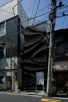 Narrow Restaurant with Unique Facade Design