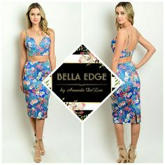 Royal floral palm crop top midi skirt set The perfect vacation piece!! 65% RAYON, 5% LYCRA. This floral print set features a cropped top with gold accents on straps, sweetheart neckline and metal hardware closure on back. Skirt is high-waisted, midi length and has a bodycon silhouette. Sizes Medium to Large. Bella Edge Boutique  Skirts Skirt Sets