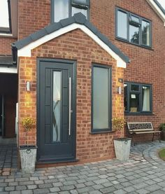 An Anthracite Grey Vermont with Haze glass Rockdoor manufacture the most secure Front doors Back Doors and Barn Doors in the UK - design your dream door today at Porch Uk, House Front Porch, Porch Doors, Front Porch Design, Up House, Barn Doors, Garage Doors, Porch Extension, House Extension Design