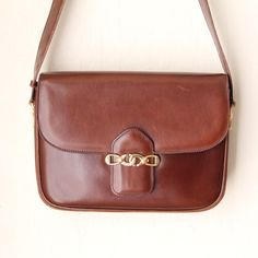 """Vintage Celine Shoulder Bag Amazing condition! Vintage Celine shoulder bag with golden medal clasp. Strap is 32"""" and can be extended an extra 7"""". Leather condition is still very nice, has a slight tear pictured. Celine Bags Shoulder Bags"""