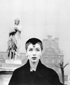 1953. Harper's Bazaar. Hotel Regina, Paris. Model Suzy Parker wearing Christian Dior.   Photo by Louise Dahl-Wolfe (1895- D1989)