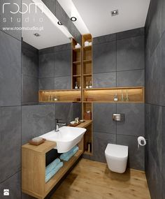 Wow, how I love this bathroom - gray tiles on the wall - wooden feeling on the floor and a clean modern - looks like a relaxing place