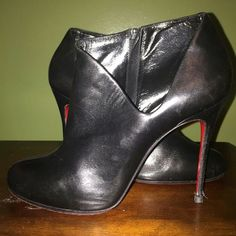 Christian Louboutin Booties ❌ No Trades ❌  PERCENT Authentic Christian Louboutin beautiful black leather Lisse 100 Nappa Booties with a side zipper on the inside and a cut out detail on the other side! Shoe worn but still in great condition? Will Negotiate for reasonable price only through offer button Christian Louboutin Shoes Ankle Boots & Booties