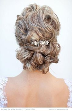 I like the back, with some loose curls in front maybe