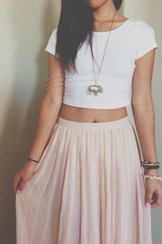 cropped white tee. maxi skirt, i would do more of a funky hippie pattern. no lame elephant necklace or armband though.