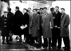 Manchester United players and officials boarding their plane at Ringway Airport bound for Belgrade in 1958. Left to Right: Walter Crickmer, Frank Swift, Albert Scanlon, Ray Wood, Dennis Viollet, Geoff Bent, Liam Whelan, Mark Jones, Harry Gregg, Ken Morgans.