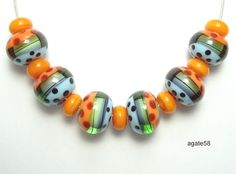 Handmade Lampwork Beads ~ Fun And Bright Spring Rondelles by 'agate58' on Etsy♥❤♥