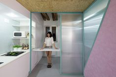 <p>Upstairs, the floor is full of trap doors designed to make use of the spaces between the apartment's existing wooden beams.</p>