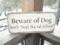 """funny pet sign """"beware of dog, don't trust the cat either"""" made of wo…"""