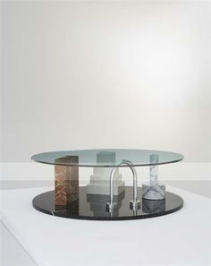 "ETTORE SOTTSASS ""Park"" coffee table, ca. 1983  Glass, metal, stone and black marble. Manufactured by UP & UP, Italy, for Memphis, Italy. 16 in. (40.6 cm) high, 51 1/4 in. (130 cm) diameter"