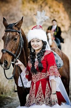 Kazakh woman with horse.                                                                                                                                                                                 More